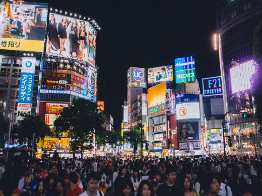 image shows a large crowd at Shibuya's famous scramble crossing