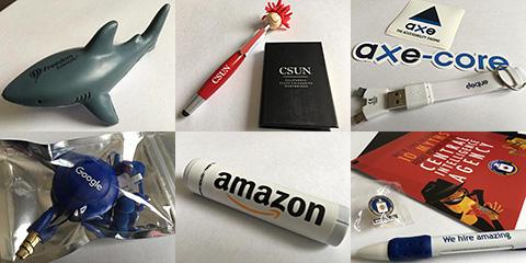 プレゼント予定の品々(上段左:Freedom Scientific社のグッズ、上段中央:CSUNのグッズ、上段右:Deque Systems社のグッズ、下段左:Google社のグッズ、下段中央:amazon社のグッズ、下段右:CIAのグッズ)